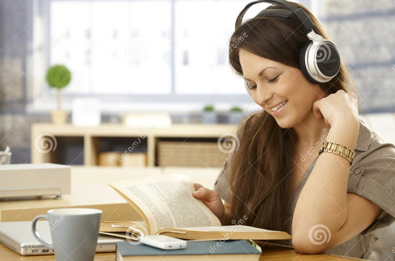 happy-woman-book-headphones-young-reading-using-smiling-33413846.jpg